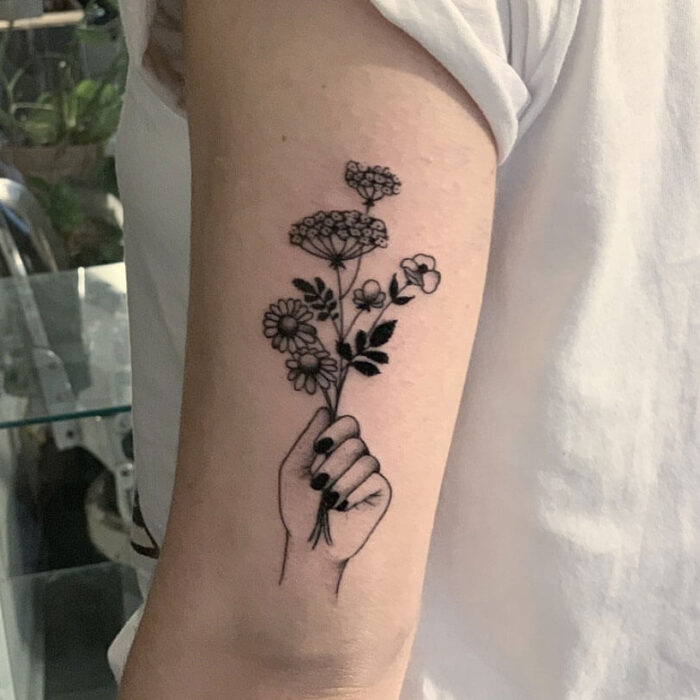 Tattoo flowers hand by Julia Hård Crooked Moon Helsingbog